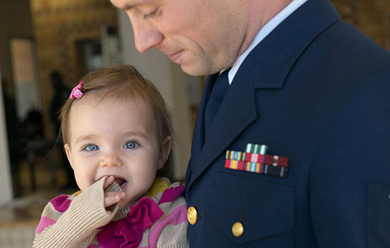 Coast Guard dad and baby 550px