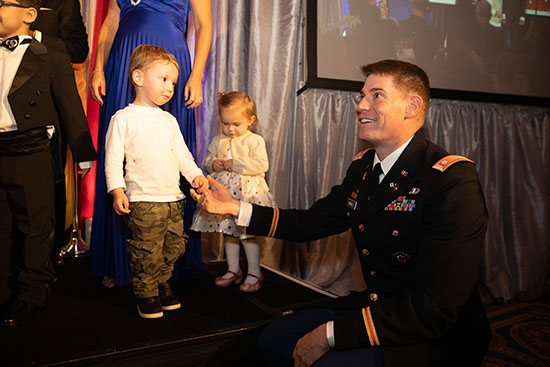 Service member and toddler 50th