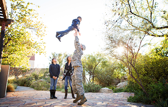 Stephens Family - Dad tosses son in the air
